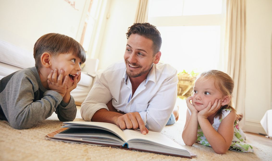 kids reading at home with parent