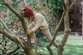 young girl climbing in tree